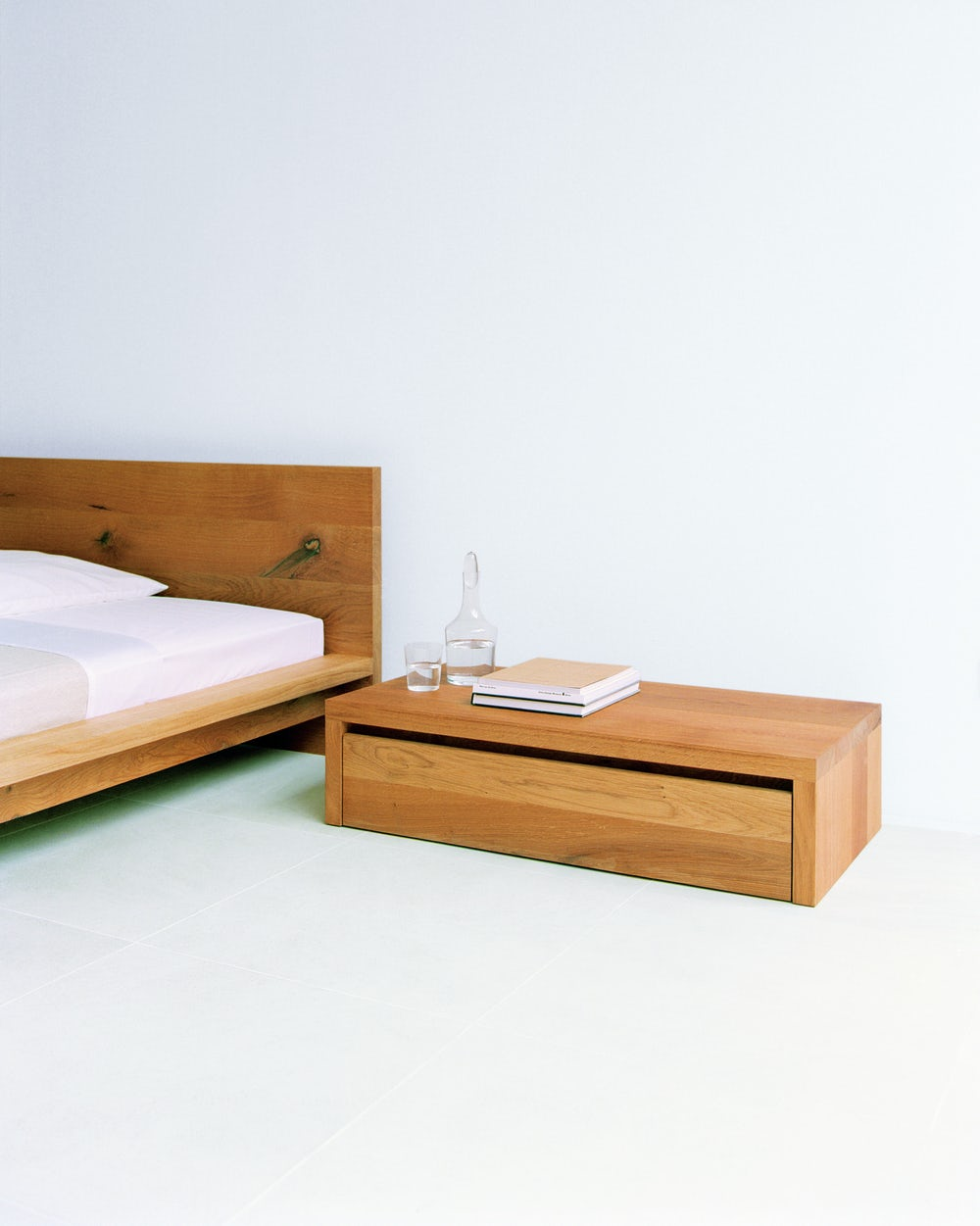 e15 emil bedside table with mo bed