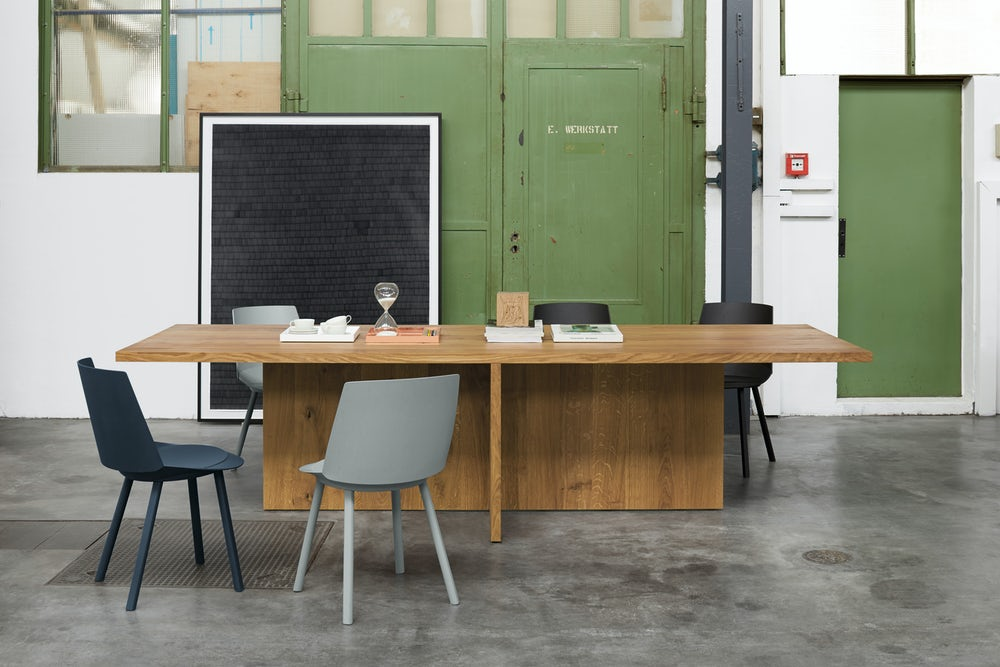 e15 zehn table with houdini side chairs in office loft