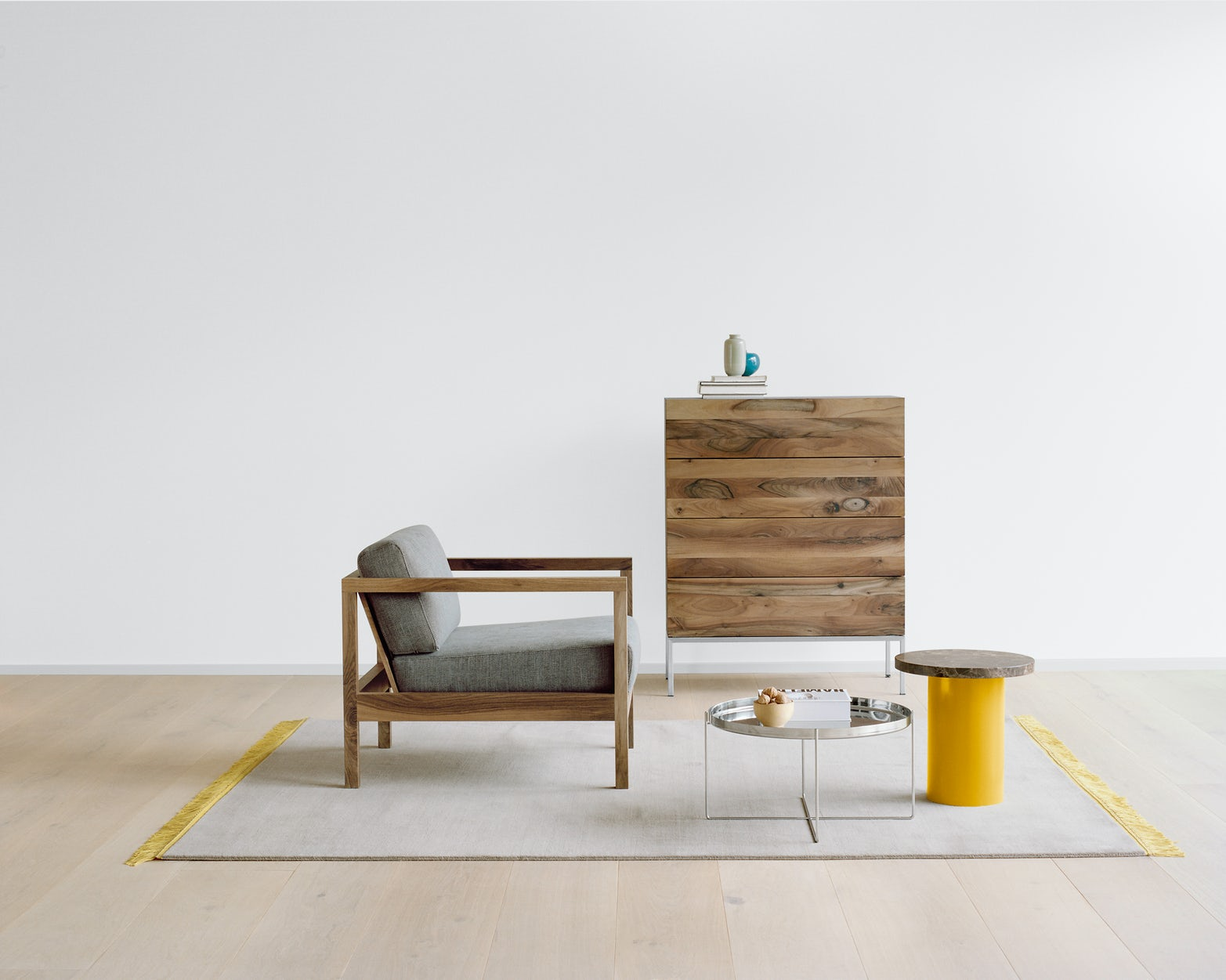 e15 habibi side table with byron lounge chair and fatima chest